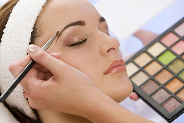 Beautiful Woman Having Make Up Applied by Beautician at Spa